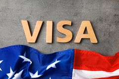 Flat lay composition with word VISA and flag of USA. On gray background royalty free stock photos