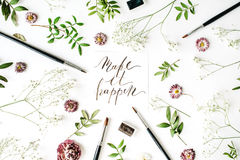 Flat lay composition, workspace with quote make it happen written in calligraphy style on white paper Stock Photography