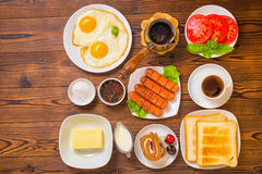 Flat lay of concept breakfast with setting food products over wo Stock Photos
