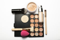 Flat lay of contouring palette,makeup brushes and mineral powder Royalty Free Stock Photo
