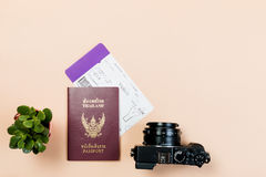 Flat lay and copy space for design work of vintage digital compact camera with Thailand passport, boarding pass, and small cactus. On yellow pastel color stock images