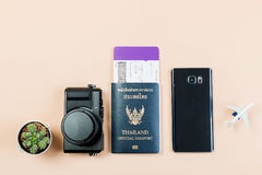 Flat lay and copy space for design work of vintage digital compact camera with Thailand official passport, boarding pass, smart ph. One, small cactus and Royalty Free Stock Image