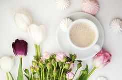 Flat lay desk with coffee and flowers Royalty Free Stock Image