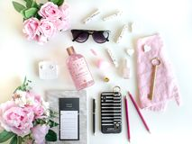 Flat lay with different accessories. Pink, rose, white, black. stock photos