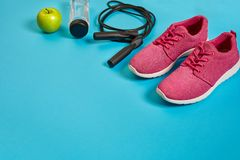 Flat lay of dumbbell, bottle of water, jump rope and sneaker, sport equipments, fitness items, top view stock images