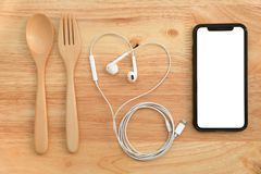 Flat lay eating and entertainment with spoon, fork,earphone and Stock Image