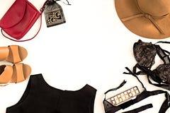 Flat lay of elegant feminine clothing and accessories Stock Photos