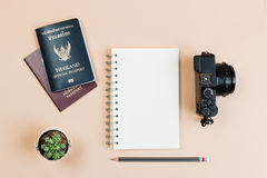 Flat lay empty book and pencil for design work. With vintage digital compact camera, Thailand official passport and smart phone and small cactus on yellow Royalty Free Stock Photos