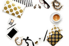 Flat lay fashion feminine home office workspace with phone, cup of coffee, stylish black gold notebooks, cosmetics and jewelry on. White background. Women`s Royalty Free Stock Photography
