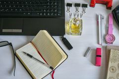 Flat lay fashion feminine home office workspace. Top view royalty free stock photos