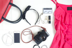 Flat lay of fashion items with film camera, smartphone, red hand Stock Photo