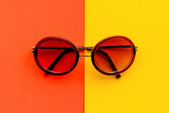 Flat lay fashion style sunglasses on colorful background Stock Images