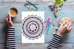 Flat lay, female coloring adult coloring book Royalty Free Stock Images