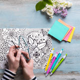 Flat lay, female coloring adult coloring book Royalty Free Stock Image