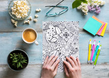 Flat lay, female coloring adult coloring books, stress relieving trend Stock Photos