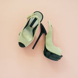 Flat lay of female shoes on a pale pink pastel background. Place for your design, text, etc Royalty Free Stock Photos