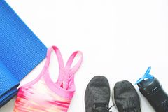 Flat lay of female sport and yoga equipments on white background Royalty Free Stock Photography