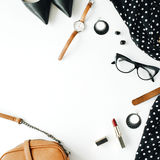 Flat lay feminine clothes and accessories collage with black dress, glasses, high heel shoes, purse, watch, mascara, lipstick, ear Stock Photos