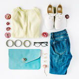 Flat lay feminine clothes and accessories collage with cardigan, jeans, glasses, bracelet stock photos