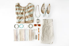 Flat lay feminine clothes and accessories collage with cardigan, trousers, sunglasses, watch, bracelet, lipstick, mint high heel royalty free stock photos