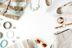 Flat lay feminine clothes and accessories collage with cardigan, trousers, sunglasses, watch, bracelet, lipstick, mint high heel s Royalty Free Stock Photos