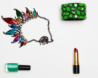 Flat lay feminini accessories collage with glasses, lipstick, bracelet, necklace on white background. Stock Image