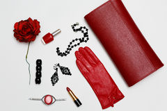Flat lay feminini red clothes and accessories collage on white background. Flat lay feminini red clothes and accessories collage on white Stock Image