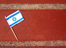 Flat lay of the flag of Israel on a brick surface Stock Image
