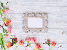 Flat lay flowers frame and vintage mirror Stock Image