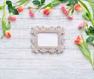 Flat lay flowers frame and vintage mirror Stock Photos