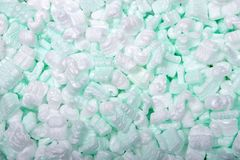 Background of white and green packing peanuts royalty free stock photography