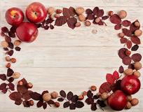 Flat lay frame of autumn crimson leaves, hazelnuts, walnuts and Stock Images
