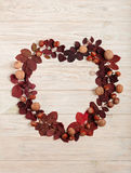 Flat lay frame in the form of a heart of autumn crimson leaves, Royalty Free Stock Images