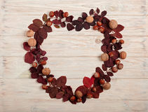 Flat lay frame in the form of a heart of autumn crimson leaves, Stock Image