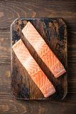 Fresh raw salmon fillet, flat lay. Flat lay with fresh raw salmon fillet. Old wooden background. Top view Stock Photo