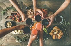 Flat-lay of friends eating and drinking together, top view Royalty Free Stock Photography