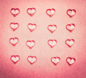 Flat lay of  glass hearts on pink background. Top view Royalty Free Stock Photo
