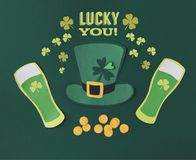 Flat lay with glasses of beer, coins, green hat, shamrocks and lucky you lettering stock photos
