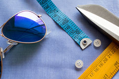 Flat lay with goggles, measuring tape, scissors, scale Royalty Free Stock Image