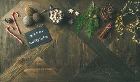 Flat-lay of greeting card, mug of hot chocolate, candy cane Royalty Free Stock Photography