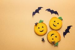 Flat lay Halloween background with decorative pumpkins, spiders Royalty Free Stock Photo