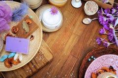 Flat lay handmade organic cosmetics: cream, artisan soap, bath salt. Empty wooden copy space for text stock images