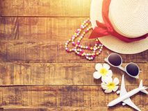 Flat lay of hat , necklace , sun glass , flower stock image