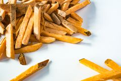 Close up heap raw sweet potato chips against white background. stock photos