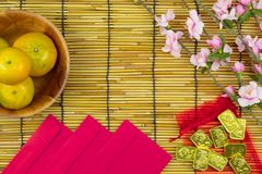 Flat lay holiday of Chinese new year red packet and of accessori. Es blossom on top and gold Lunar festival concept background, Other language means wealthy or stock photo