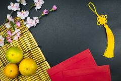 Flat lay holiday of Chinese new year red packet and of accessori. Es blossom on top and Lunar festival concept background, Other language means wealthy or rich stock images