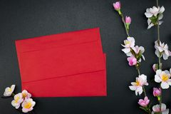 Flat lay holiday of Chinese new year red packet and of accessori. Es blossom on top and Lunar festival concept background, Other language means wealthy or rich stock image