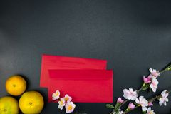 Flat lay holiday of Chinese new year red packet and of accessori. Es blossom on top and Lunar festival concept background, Other language means wealthy or rich royalty free stock photography
