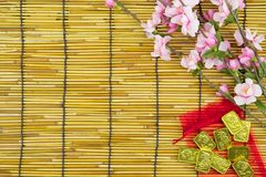 Flat lay holiday of Chinese new year red packet and of accessori. Es blossom on top and gold Lunar festival concept background, Other language means wealthy or royalty free stock image