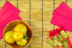 Flat lay holiday of Chinese new year red packet and of accessori. Es blossom on top and gold Lunar festival concept background, Other language means wealthy or stock photos
